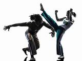 couple capoiera dancers dancing   silhouette