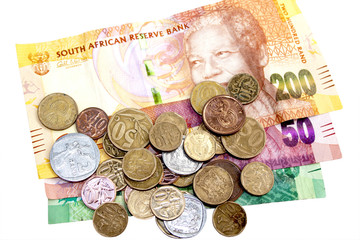 Scattered  Coins on Three South African Bank Notes
