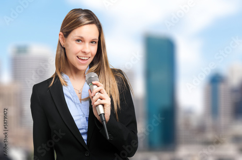 Woman presenting with a microphone