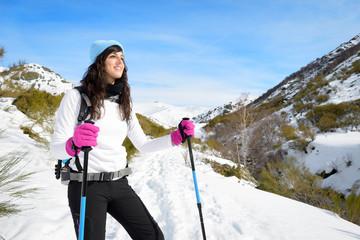 Woman hiking in winter mountain