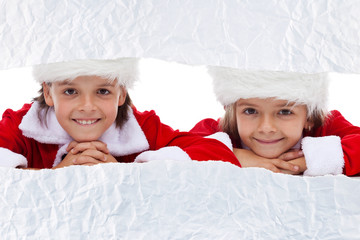 Kids watching the unwrapping christmas present