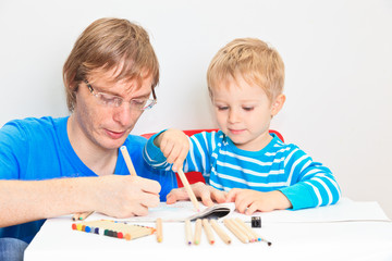 father and son drawing together, early education