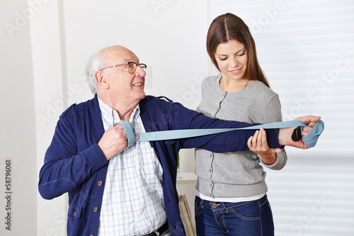 Old man at rehabilitation in physiotherapy