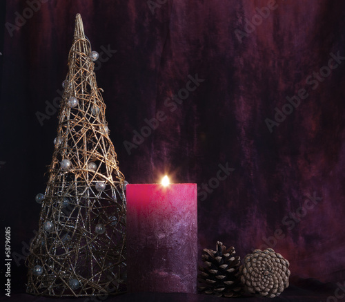 Christmas background.Tree,candle and pine cones.