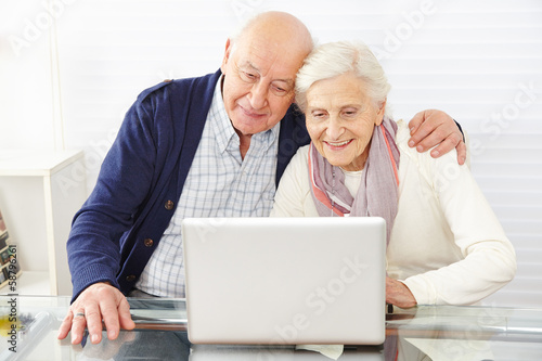 Senior couple using ecommerce in internet