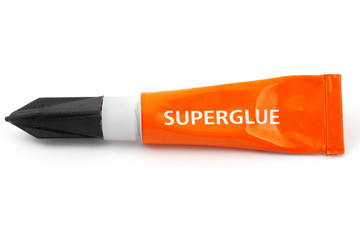 orange plastic tube labeled superglue