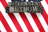 USA flag with government shutdown words in metal type