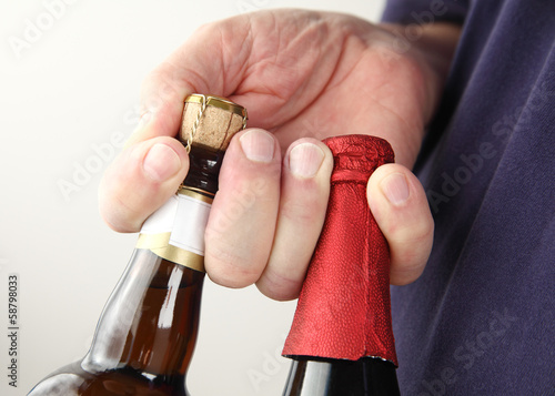 man holds beer bottles