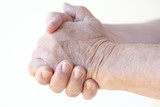 clasped hands of older man