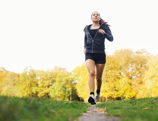 Healthy young woman jogging in park