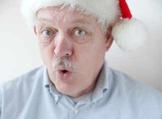 businessman wearing Santa hat says 'Ho ho ho'