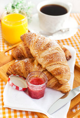 Breakfast with croissants, cup of coffee and orange juice