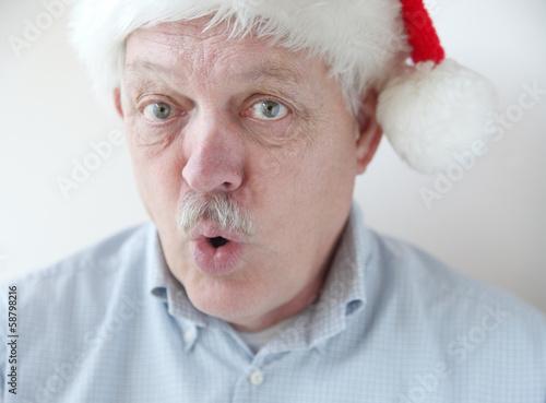 businessman wearing Santa hat says 'Ho ho ho'