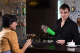 Young woman having a drink at the bar