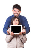 Happy Young Couple with Tablet PC
