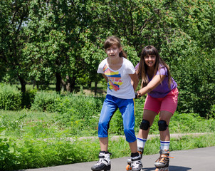 Two young women having fun rollerblading