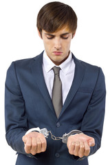 young Caucasian male arrested for tax evasion
