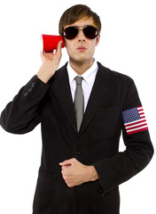American spy wearing black suit and holding a cup