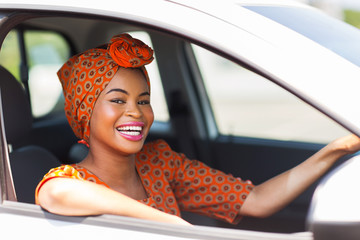 young african woman in a car