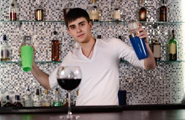 Barman mixing cocktails at the bar