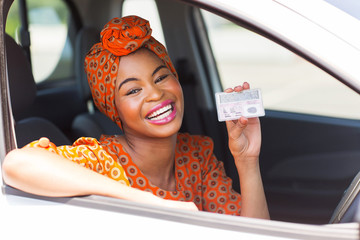 african american woman showing a driving license