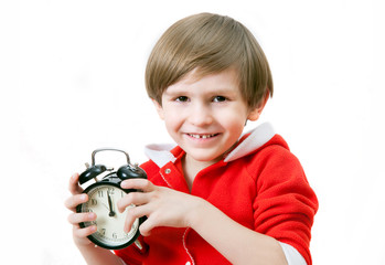 The small boy with alarm clock in Christmas night