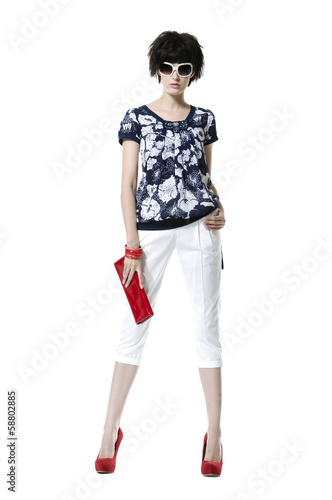 fashion model wearing sunglasses holding red purse