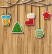 Christmas card with balls, stars, gift on wood background