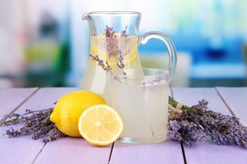 Lavender lemonade, on  violet wooden table, on bright