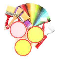 Set for painting: paint pots, brushes, paint-roller, palette of
