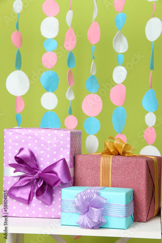 Beautiful presents on table on bright background