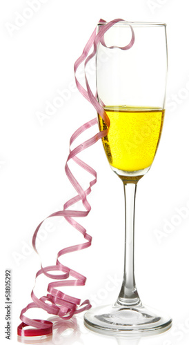 Glass of champagne and streamer after party isolated on white