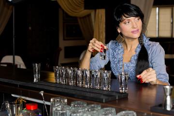 Woman drinking vodka shots at a bar