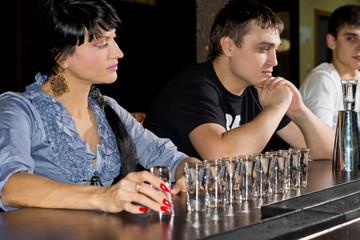 Woman drinking vodka at the bar