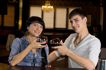 Attractive young couple posing at the bar