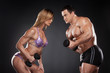 Competition between female and male bodybuilder.