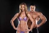 Sexy couple of fit man and woman showing muscular.