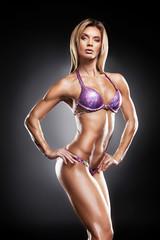 Beautiful female bodybuilder showing her sexy body.