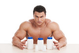 Muscular handsome bodybuilder with pills and dope. poster