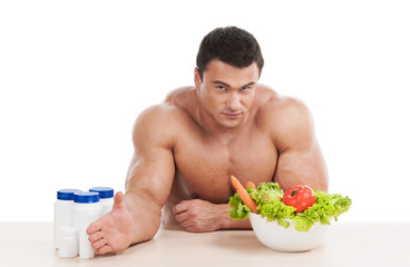 Healthy  handsome man choosing healthy food instead of steroid.