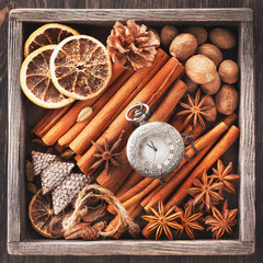 Christmas spices, vintage watch on a chain and Christmas toys