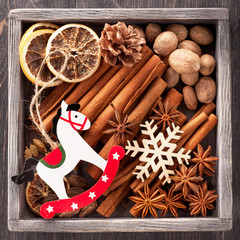 Christmas spices and Christmas toys in vintage wooden box