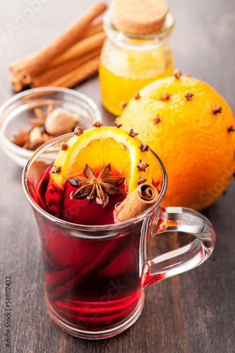 Hot Christmas drink (mulled wine) with spices and orange