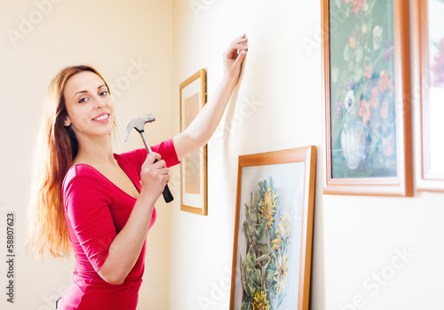 Smiling  woman in red hanging  art picture
