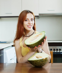 Positive girl with ripe melon