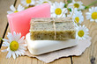 Soap with chamomile on a board