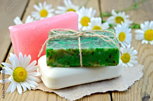 Soap homemade with chamomile on a board
