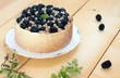 Creamy cheesecake with blackberries and white currants.
