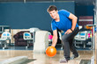 Young man bowling having fun