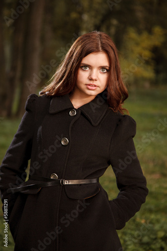 young female in black coat